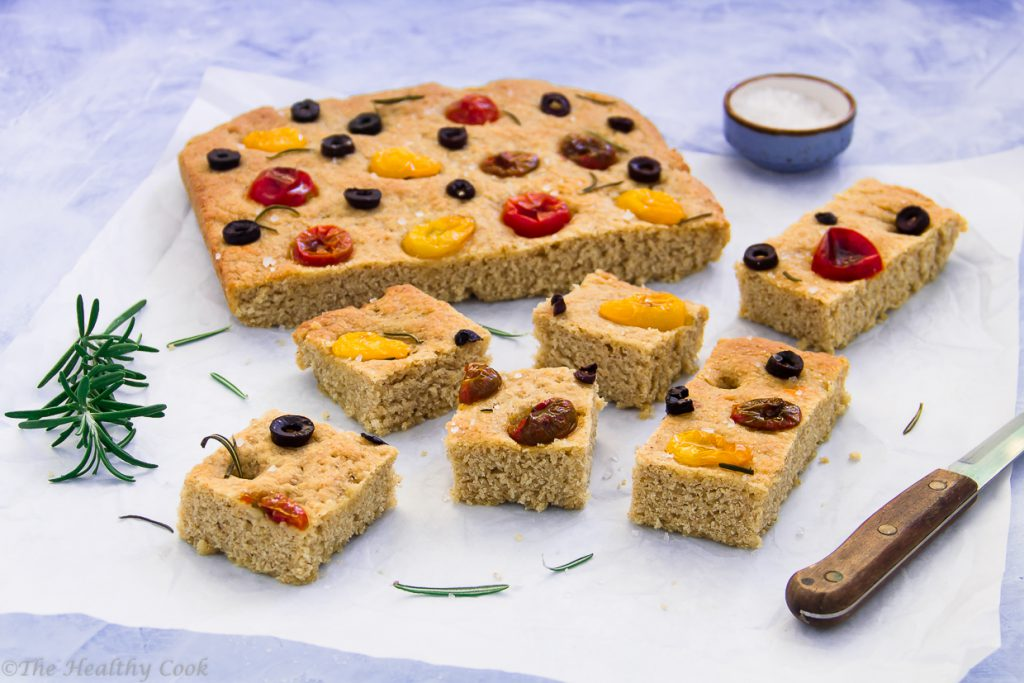 Whole wheat focaccia with cherry tomatoes, Kalamata olives & rosemary